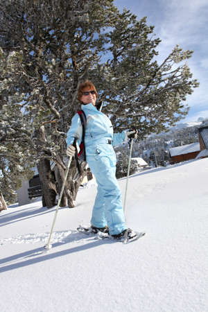 a mature woman doing snow board photo