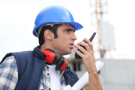 A foreman giving instructions through his cb  photo