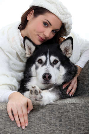 Portrait of a young woman with husky photo