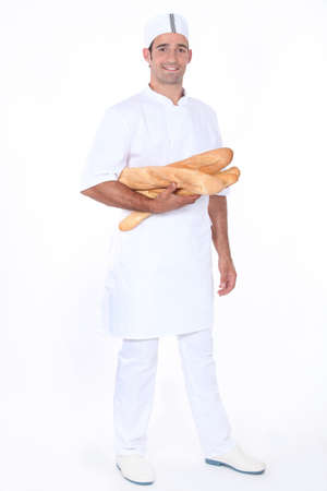 Baker with loaves of bread photo