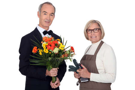 55 to 60: Man getting flowers from florist