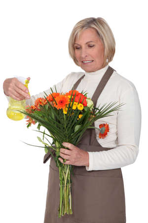 middle age women: elderly woman holding bouquet Stock Photo