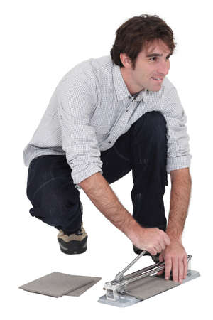 handyman laying tiles Stock Photo - 13344149