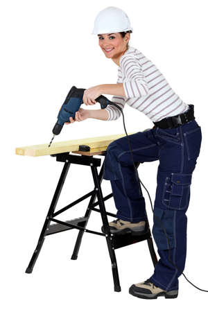 Girl using drill Stock Photo - 13343874