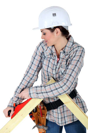 chiseled: Woman using a carpentry plane Stock Photo