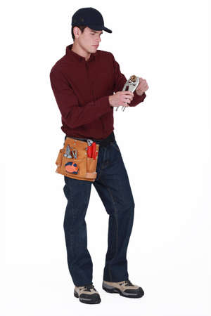 Plumber with a pair of grips Stock Photo - 13343966