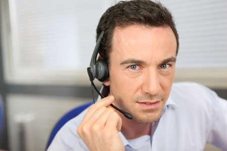 telemarketing: Man wearing a headset