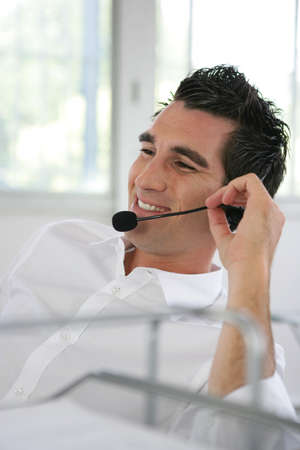 Man wearing a headset photo