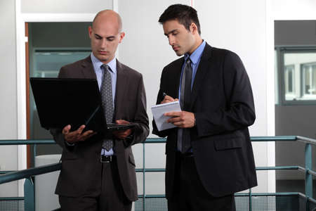 two young businessmen working together Stock Photo - 13343924
