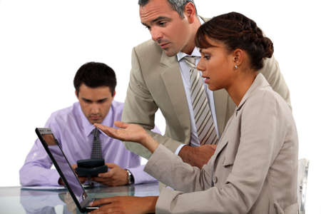 Office workers with a laptop Stock Photo - 13344213