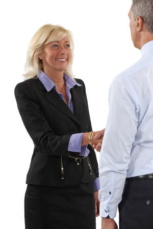 congratulating: Two senior businesspeople shaking hands