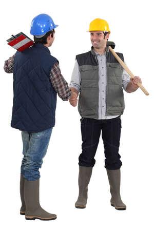 Construction workers handshaking Stock Photo - 13344005