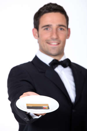 giving back: Waiter giving back credit card