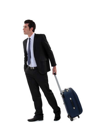 tugging: Businessman with a suitcase