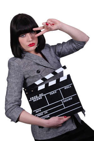 Woman with a clapperboard photo