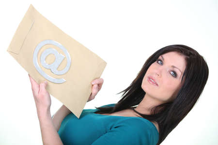 30 years old woman: Woman holding an envelope with an at sign on it Stock Photo