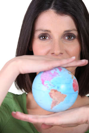 Woman holding miniature globe photo