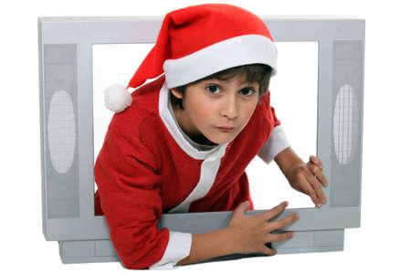 portrait of a kid in Santa Claus costume photo