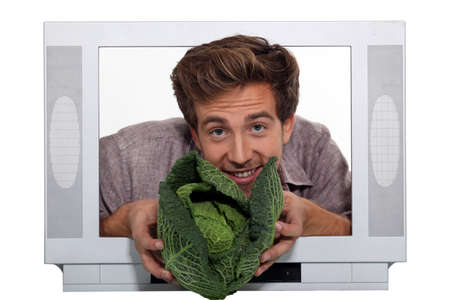 Man presenting cabbage