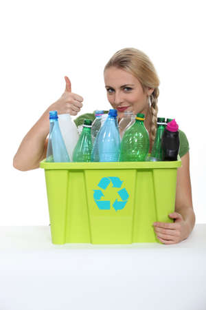 international recycle symbol: Woman promoting recycling