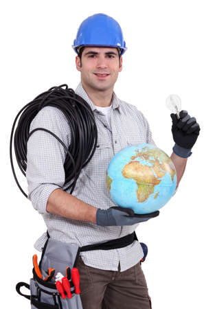 craftsman holding a bulb and a globe photo