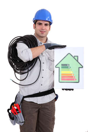 energy performance certificate: Tradesman holding an energy efficiency rating chart