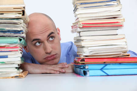 much: man overwhelmed with folders Stock Photo