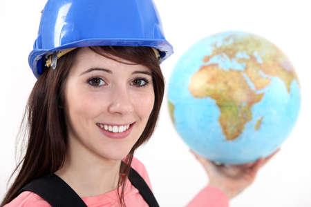 workwoman: Tradeswoman holding a globe Stock Photo