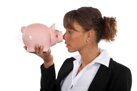credit union: businesswoman holding a pig bank