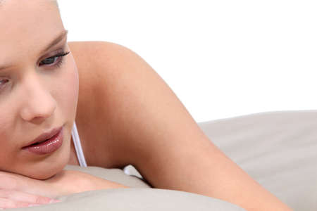 loosen up: Sad blond woman in bed
