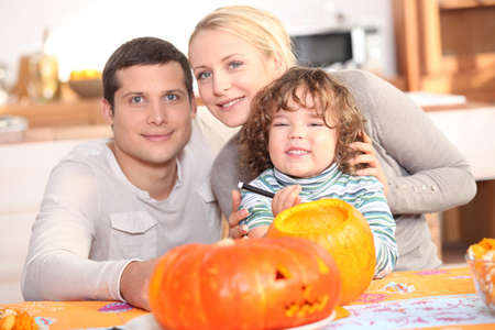 Family carving a pumpkin together photo