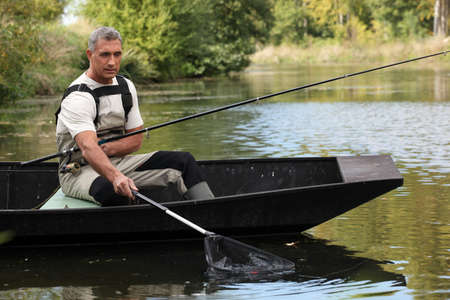 Man out fishing Stock Photo - 13344110