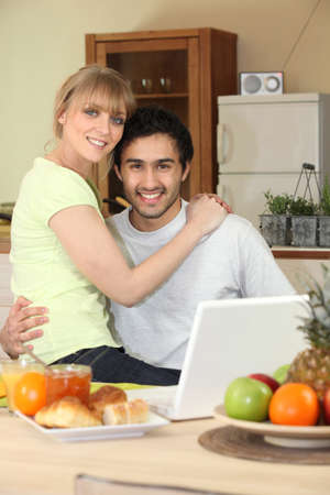 Affectionate young couple in the kitchen photo