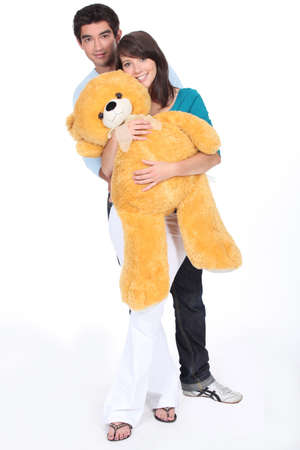 portrait of teenagers with big teddy bear photo