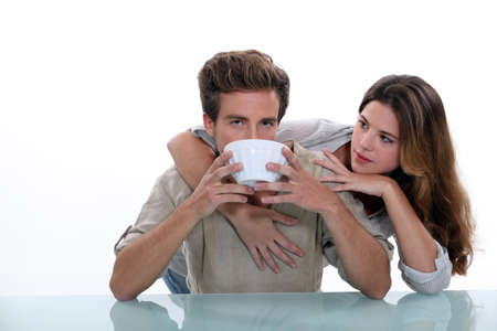 breakfasting: Couple with large bowl of coffee Stock Photo
