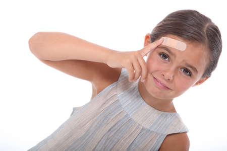 injured: Injured child with a plaster on her forehead Stock Photo