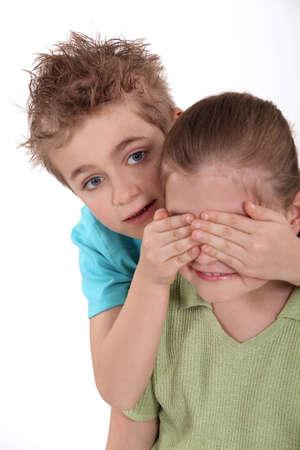peekaboo: Children playing peekaboo Stock Photo