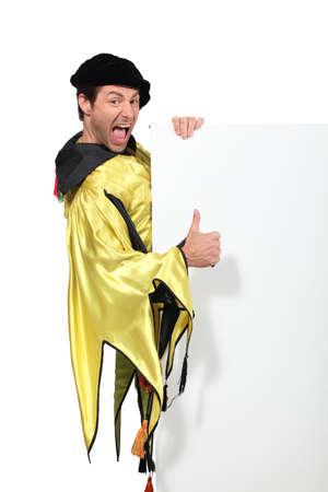 Man with yellow dress Stock Photo - 13344003
