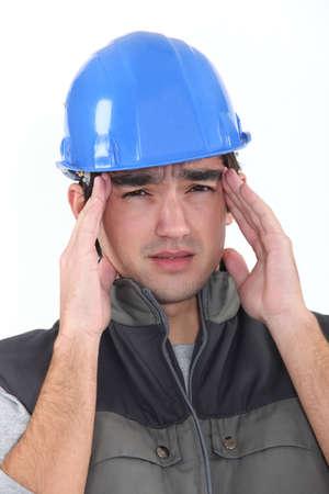 obrero: Constructor con dolor de cabeza