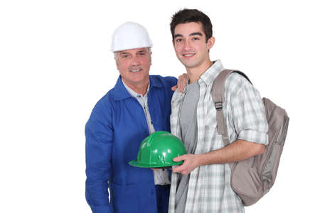 first job: Construction worker and his apprentice Stock Photo