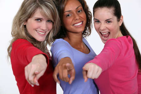 A group of young women pointing their fingers photo