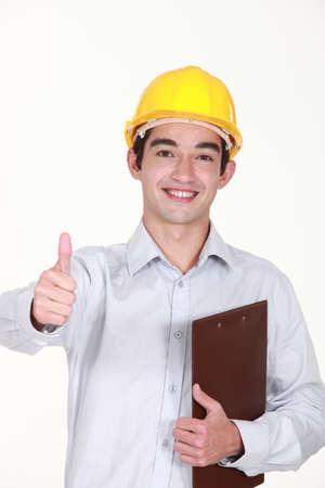 Thumbs up from a builder with a clipboard Stock Photo - 13344042
