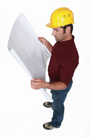 Tradesman examining a technical drawing Stock Photo - 13343847