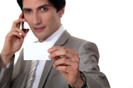 Man holding up his business card photo