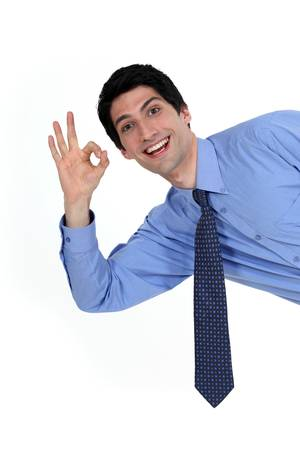 enraptured: Enthusiastic man giving the a-ok sign Stock Photo