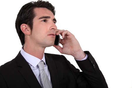 Executive using a cellphone Stock Photo - 13344255