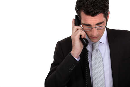Businessman using a landline photo