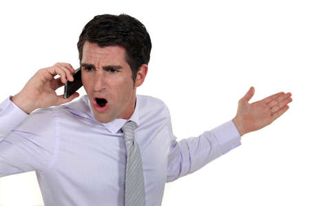 angry businessman talking on his cell photo