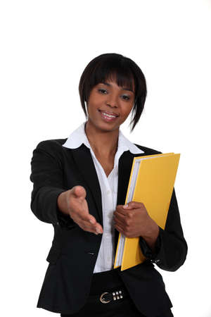 quotas: black businesswoman holding filer