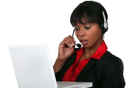 Businesswoman wearing a headset with a laptop photo